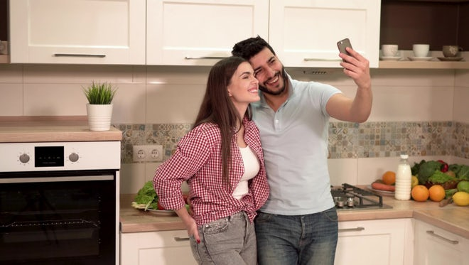 Beautiful Young Couple Taking Selfies: Stock Video