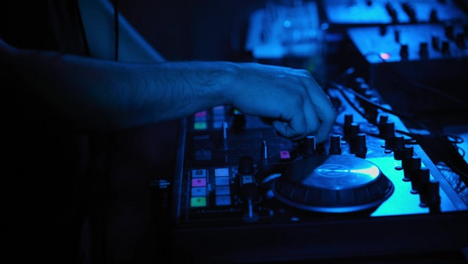 DJ Mixing Tracks In Club: Stock Video